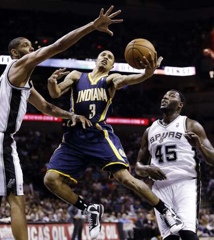Indiana Pacers' George Hill (3) is defended by San Antonio Spurs' Tim Duncan, left, and DeJuan Blair (45) as he drives to the basket during the second quarter of an NBA basketball game, Monday, Nov. 5, 2012, in San Antonio. (AP Photo/Eric Gay) (Associated Press)