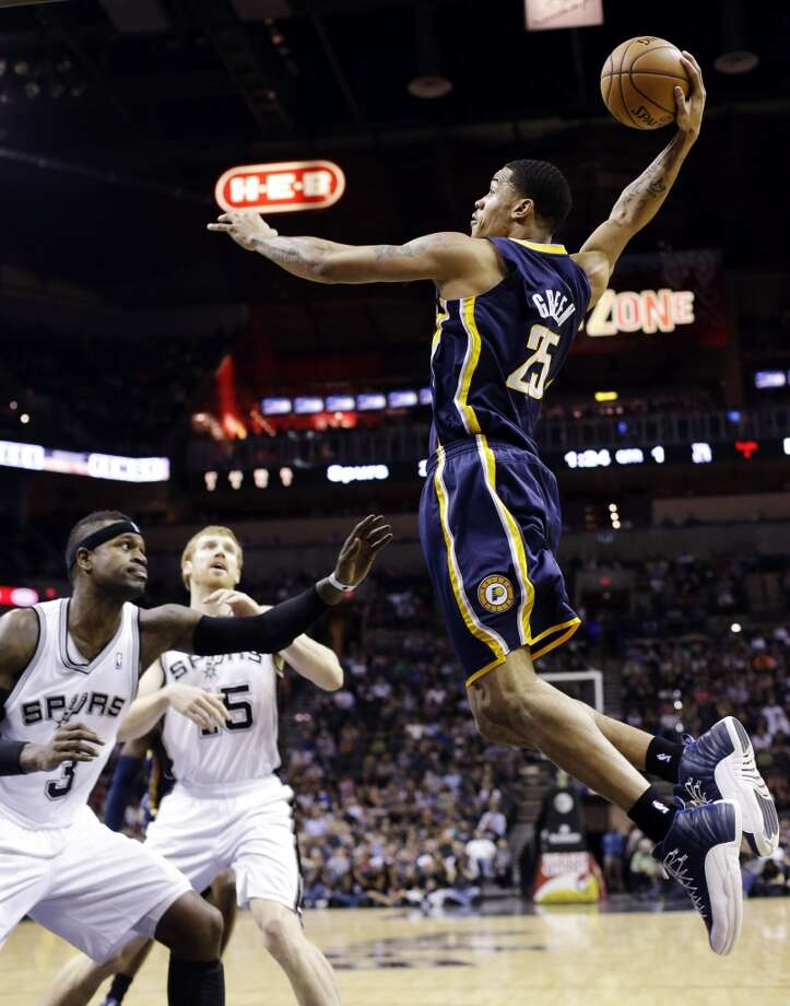 Indiana Pacers' Gerald Green (25) scores over San Antonio Spurs' Stephen Jackson (3) and Matt Bonner (15) during the first quarter of an NBA basketball game, Monday, Nov. 5, 2012, in San Antonio. (AP Photo/Eric Gay) (Associated Press)