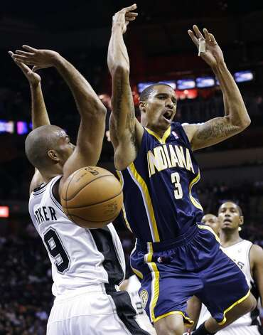 Indiana Pacers' George Hill (3) is fouled by San Antonio Spurs' Tony Parker (9), of France, during the first quarter of an NBA basketball game, Monday, Nov. 5, 2012, in San Antonio. (AP Photo/Eric Gay) (Associated Press)
