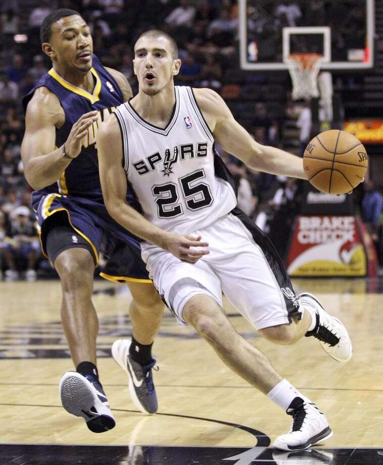 San Antonio Spurs' Nando De Colo drives around Indiana Pacers' Orlando Johnson during second half action Monday Nov. 5, 2012 at the AT&T Center. The Spurs won 101-79. (Edward A. Ornelas / San Antonio Express-News)