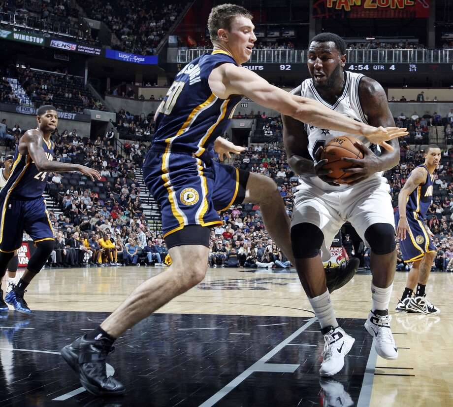 San Antonio Spurs' DeJuan Blair looks for room around Indiana Pacers' Tyler Hansbrough during second half action Monday Nov. 5, 2012 at the AT&T Center. The Spurs won 101-79. (Edward A. Ornelas / San Antonio Express-News)