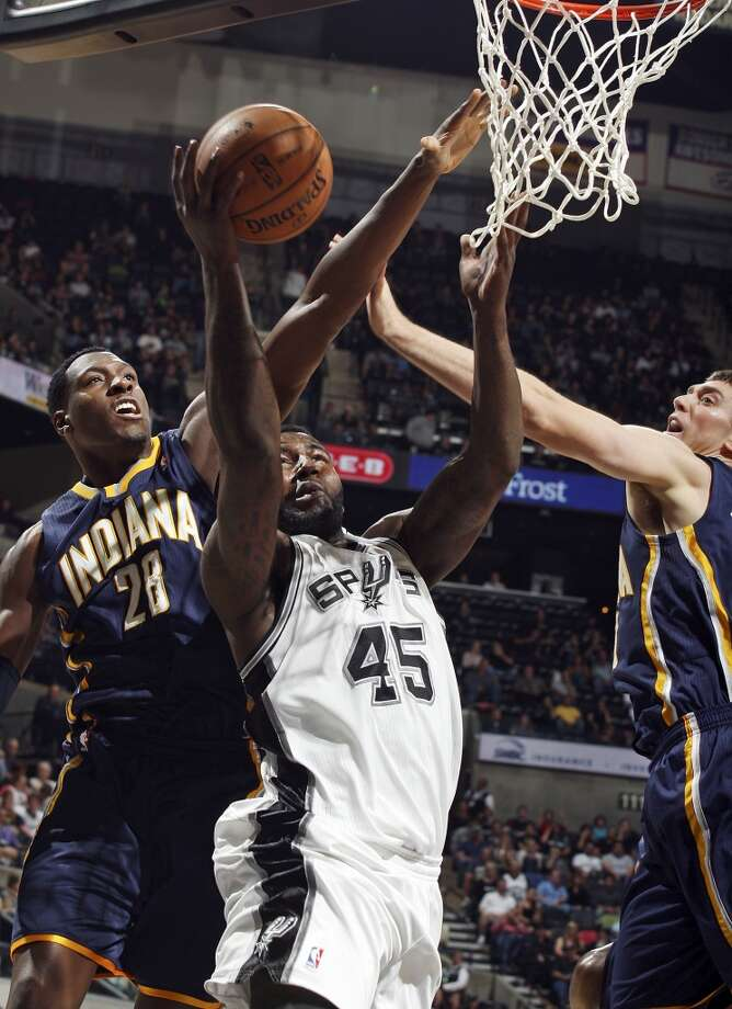 San Antonio Spurs' DeJuan Blair shoots between Indiana Pacers' Ian Mahinmi (left) and Tyler Hansbrough during second half action Monday Nov. 5, 2012 at the AT&T Center. The Spurs won 101-79. (Edward A. Ornelas / San Antonio Express-News)