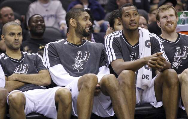 San Antonio Spurs' Tony Parker (from left), Tim Duncan, Boris Diaw, and Matt Bonner relax on the bench during second half action against the Indiana Pacers Monday Nov. 5, 2012 at the AT&T Center. The Spurs won 101-79. (Edward A. Ornelas / San Antonio Express-News)