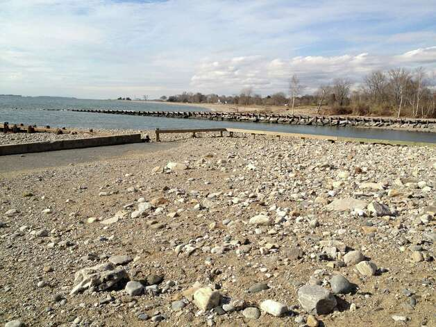 The Burying Hill Beach parking lot was strewn with sand and rocks after Superstorm Sandy hit Westport. Photo: Contributed Photo / Westport News contributed