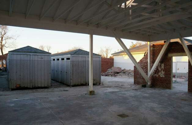 Superstorm Sandy knocked out the brick wall between the bathhouses and pavilion at Compo Beach. Photo: Paul Schott / Westport News