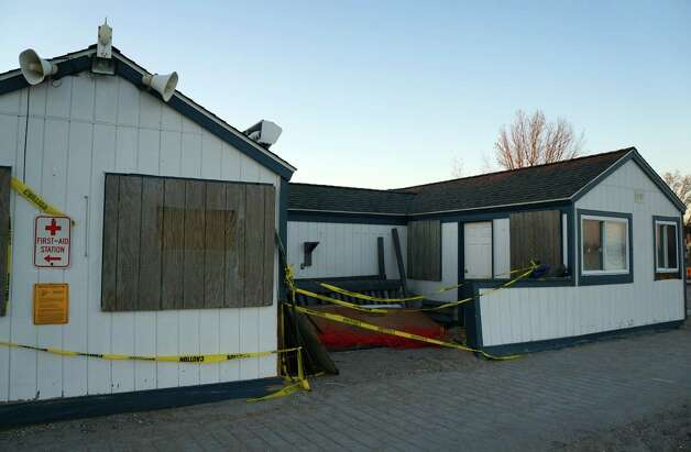 The lifeguard shack at Compo Beach stands boarded up in the aftermath of Superstorm Sandy. Photo: Paul Schott / Westport News
