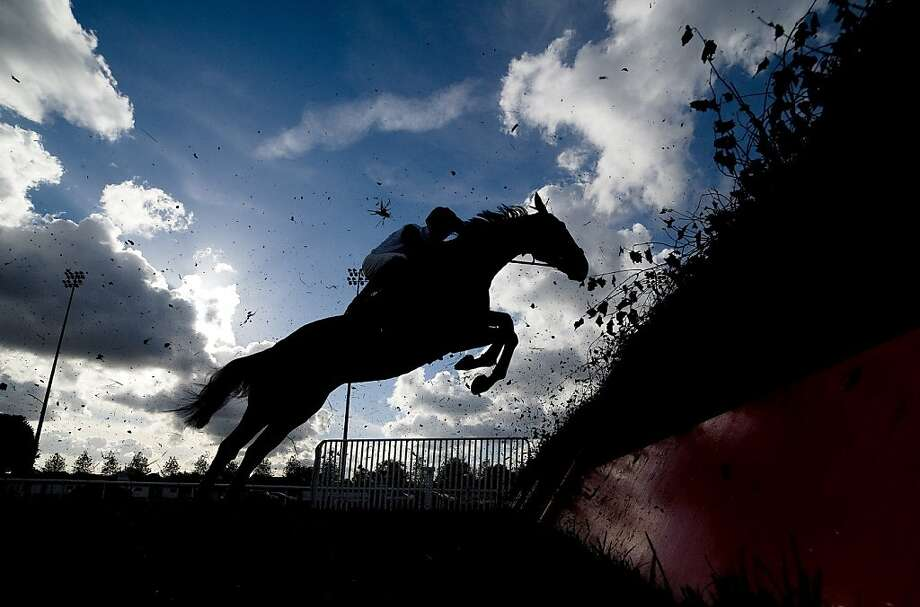 A runner takes a flight of hurdles at Kempton racecourse on November 05, 2012 in Sunbury, England. Photo: Alan Crowhurst, Getty Images
