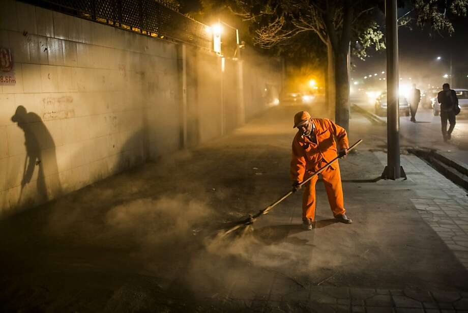 A man works to sweep a street on November 5, 2012 in Kabul, Afghanistan. Photo: Daniel Berehulak, Getty Images