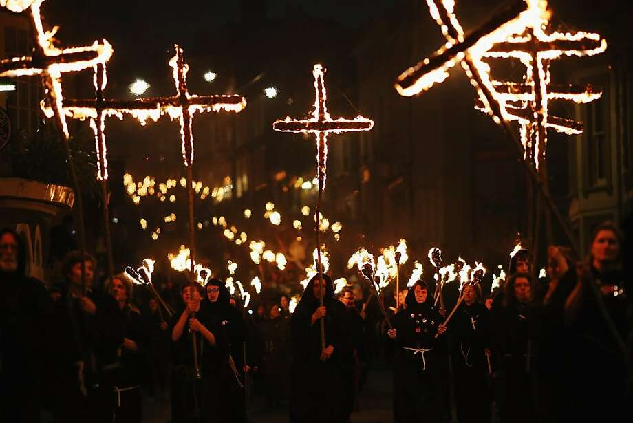 Revelers walk with burning crosses during the Bonfire Night celebrations on November 5, 2012 in Lewes, Sussex in England. Bonfire Night is related to the ancient festival of Samhain, the Celtic New Year. Processions held across the South of England culminate in Lewes on November 5, commemorating the memory of the seventeen Protestant martyrs. Thousands of people attend the parade as Bonfire Societies parade through the narrow streets until the evening comes to an end with the burning of an effigy, or 'guy,' usually representing Guy Fawkes, who died in 1605 after an unsuccessful attempt to blow up The Houses of Parliament. Photo: Dan Kitwood, Getty Images