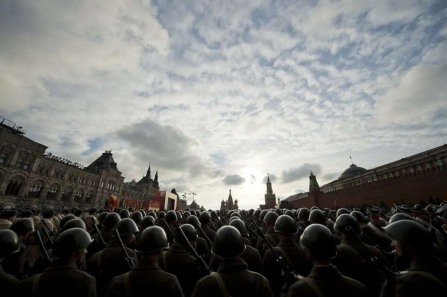 Russian soldiers wearing Soviet Union WWII military uniforms participate in the rehearsal of a military parade on the Red square in Moscow on November 5, 2012. The event will take place on November 7, marking the 71th anniversary of a historical parade of 1941, when soldiers left for a front line just after marching here, as Nazi German troops were fighting with Soviet soldiers a few kilometers from Moscow. Photo: Natalia Kolesnikova, AFP/Getty Images