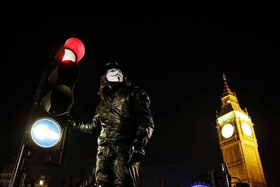 "Members of the Anonymous group protest outside the Houses of Parliament on November 5, 2012 in London, England. The group wear masks inspired by a character from the film ""V for Vendetta"", which culminates in the march en masse of the public against parliament, in protest against a authoritarian goverment, on the fifth of November. Photo: Matthew Lloyd, Getty Images"