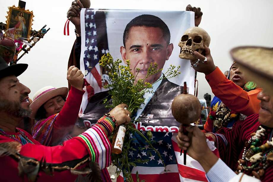 Peruvian shamans bless President Barack Obama using a poster of him during a ritual to predict the winner of the U.S. presidential election in Lima, Peru, Monday, Nov. 5, 2012. The shamans routinely predict outcomes for elections and sporting events, and on Monday predicted Obama will win. Photo: Rodrigo Abd, Associated Press