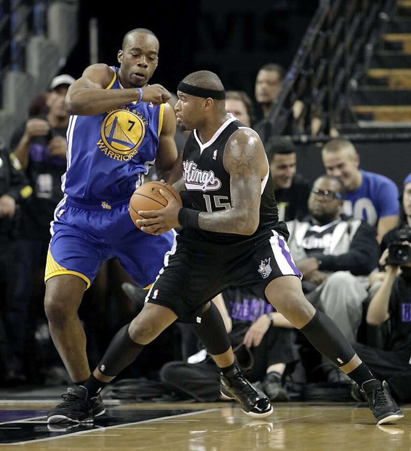 Kings center DeMarcus Cousins (right) challenges the Warriors' Carl Landry. Photo: Rich Pedroncelli, Associated Press