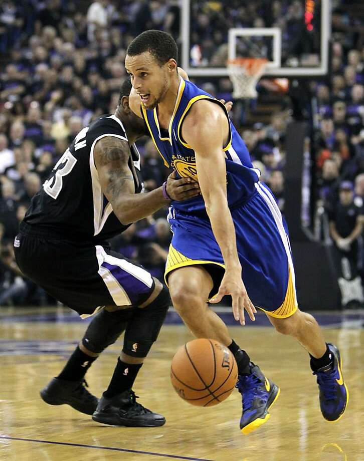 Golden State Warriors guard Stephen Curry, right, drives past Sacramento Kings guard Marcus Thornton during the first half of an NBA basketball game in Sacramento, Calif., Monday, Nov. 5, 2012. (AP Photo/Rich Pedroncelli) Photo: Rich Pedroncelli, Associated Press