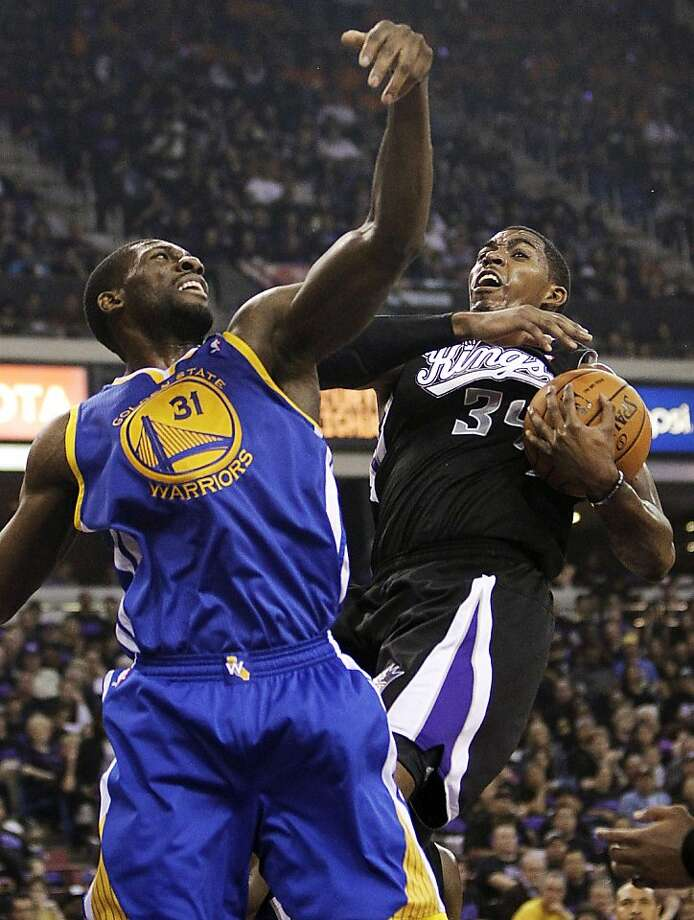 Sacramento Kings forward Jason Thompson, right, pulls the rebound away from Golden State Warriors center Festus Ezeli, of Nigeria, during the first half of an NBA basketball game in Sacramento, Calif., Monday, Nov. 5, 2012. (AP Photo/Rich Pedroncelli) Photo: Rich Pedroncelli, Associated Press