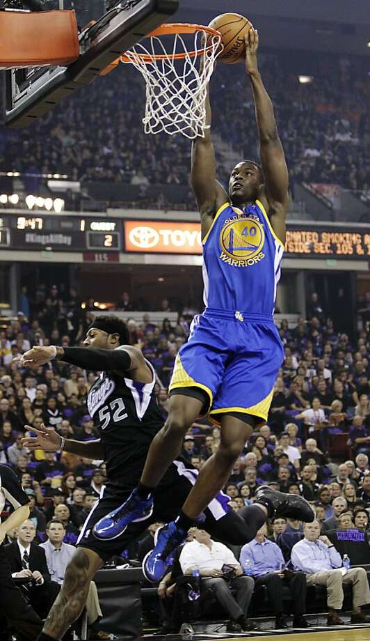 Golden State Warriors forward Harrison Barnes (40) dunks over Sacramento Kings forward James Johnson during the first quarter of an NBA basketball game in Sacramento, Calif., Monday, Nov. 5, 2012. (AP Photo/Rich Pedroncelli) Photo: Rich Pedroncelli, Associated Press