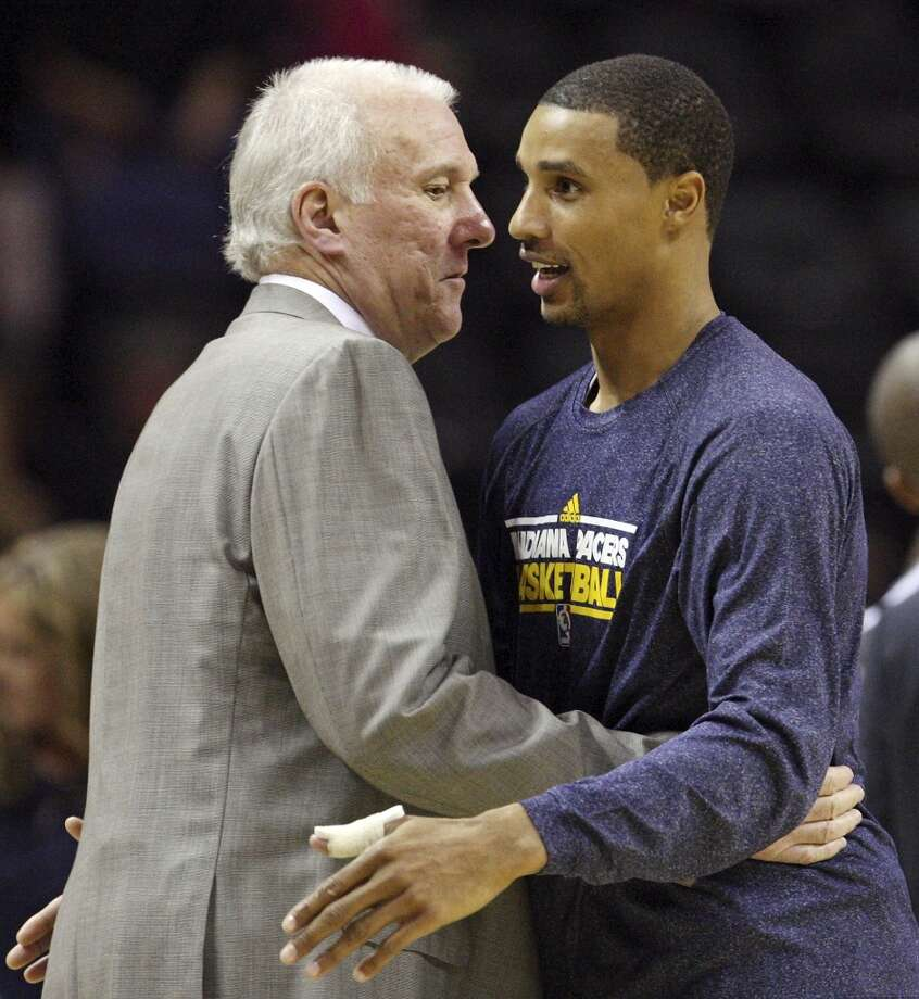 San Antonio Spurs head coach Gregg Popovich hugs former player Indiana Pacers' George Hill after the game Monday Nov. 5, 2012 at the AT&T Center. The Spurs won 101-79. (Edward A. Ornelas / San Antonio Express-News)