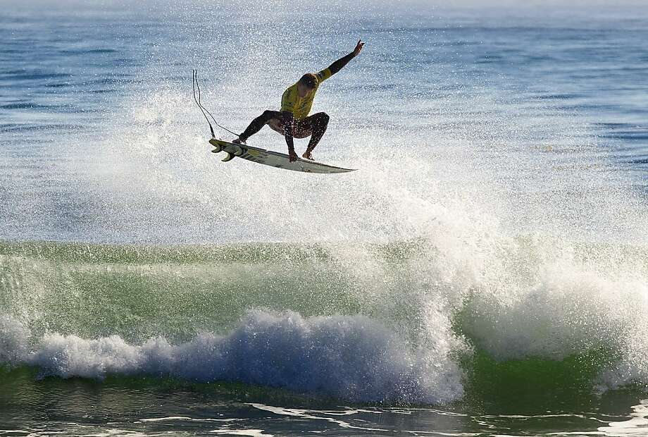 Surfing, like sailing, is a water sport that offers freedom and pure elemental thrills, as Michel Bourez of French Polynesia shows at the O'Neill Coldwater Classic in Santa Cruz. Photo: Sean Rowland, Associated Press