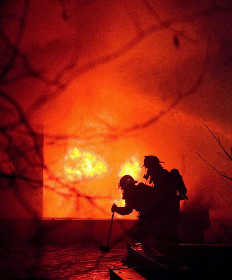 Firefighters battle a blaze at the Gastineau Apartments on Monday, Nov. 5, 2012, in Juneau, Alaska.  A deputy fire chief says he has no confirmed reports of any injuries at the Gastineau Apartments. Photo: Michael Penn, Associated Press