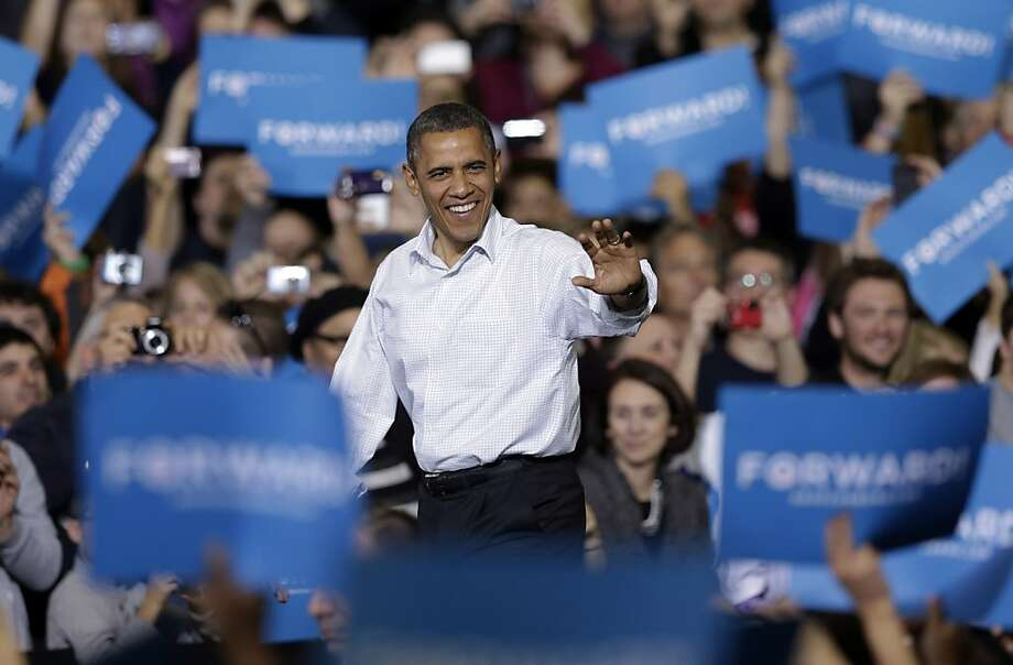 In this Nov. 3, 2012 file photo, President Obama waves as he is introduced at a campaign event in Milwaukee. (AP Photo/Morry Gash, File) Photo: Morry Gash, Associated Press