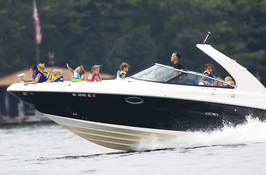 In this July 14, 2012 file photo, Mitt Romney takes his family for a boat ride on Lake Winnipesaukee in Wolfeboro, N.H. (AP Photo/Evan Vucci, File) Photo: Evan Vucci, Associated Press