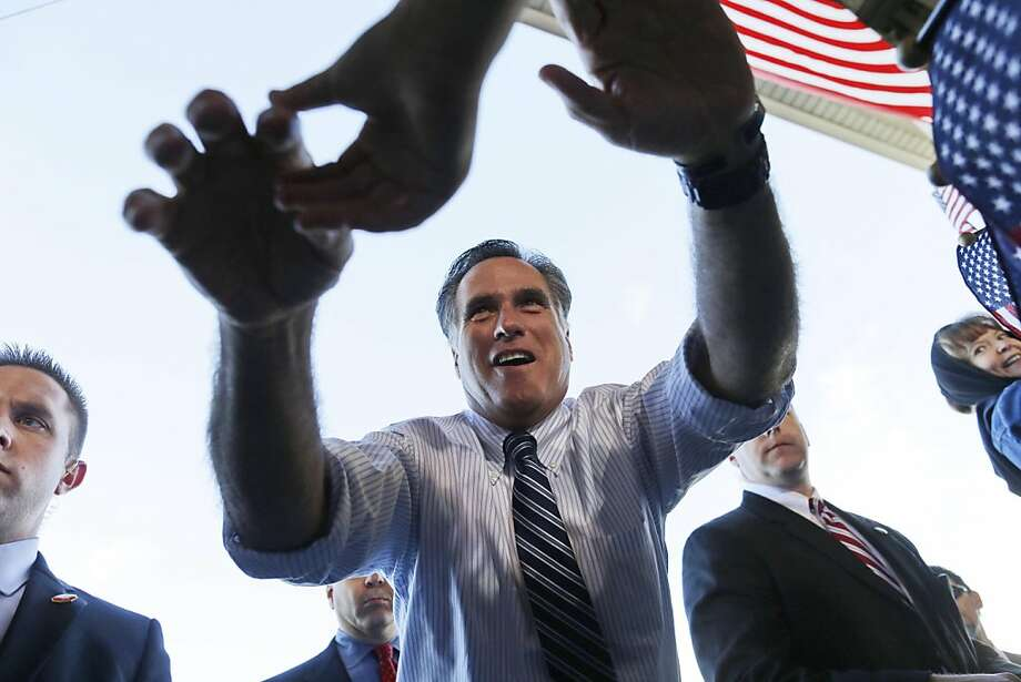 In this Nov. 3, 2012 file photo, Mitt Romney reaches out to shake hands with supporters as he campaigns at Colorado Springs Municipal Airport in Colorado Springs, Colo. (AP Photo/Charles Dharapak, File) Photo: Charles Dharapak, Associated Press