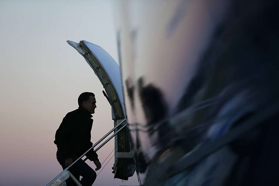 In this Nov. 2, 2012 file photo, Mitt Romney boards his plane in Norfolk, Va., as he travels to campaign events in Milwaukee. (AP Photo/Charles Dharapak, File) Photo: Charles Dharapak, Associated Press