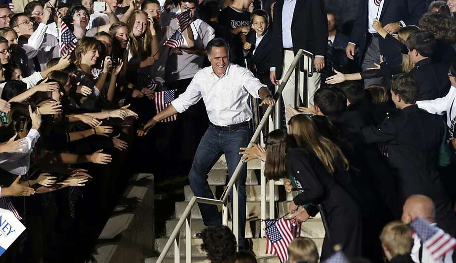 In this Sept. 23, 2012 file photo, Mitt Romney greets the crowd during a campaign event at D'Evelyn High School in Denver. (AP Photo/Charles Dharapak, File) Photo: Charles Dharapak, Associated Press