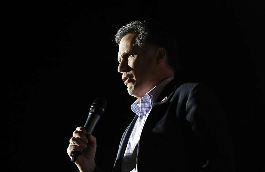 """In this Jan. 30, 2012 file photo, Mitt Romney sings """"America the Beautiful"""" as he campaigns at Lake Sumter Landing, The Villages, Fla. (AP Photo/Charles Dharapak, File) Photo: Charles Dharapak, Associated Press"""