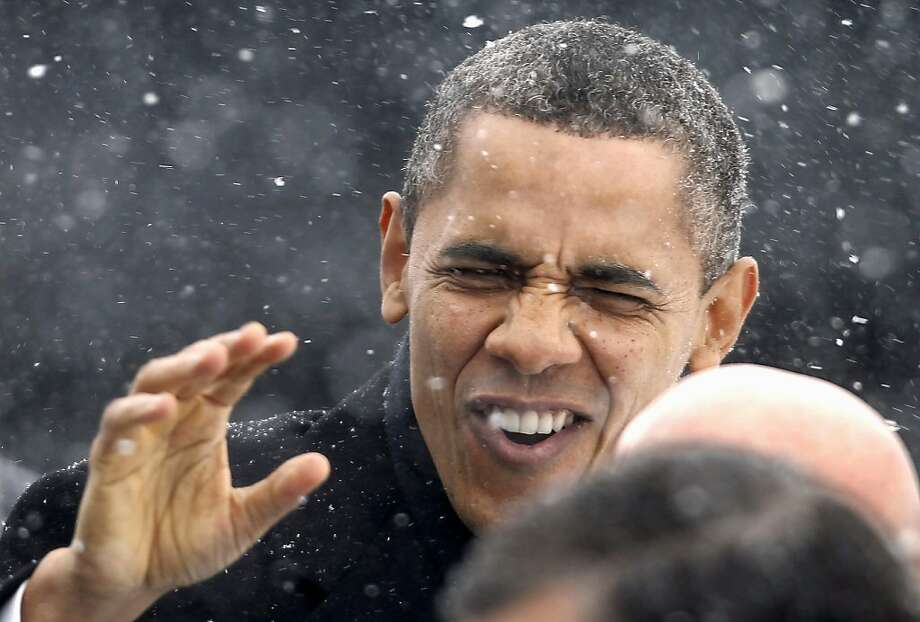 In this March 1, 2012 file photo, President Obama waves to the crowd as he walks through a snowstorm after getting off Air Force One in Manchester, N.H. (AP Photo/Winslow Townson, File) Photo: Winslow Townson, Associated Press