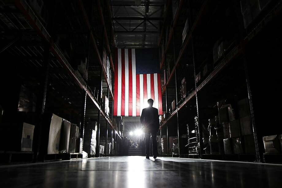 In this Feb. 1, 2012 file photo, Mitt Romney walks away from the stage after a campaign rally in Las Vegas. (AP Photo/Gerald Herbert, File) Photo: Gerald Herbert, Associated Press