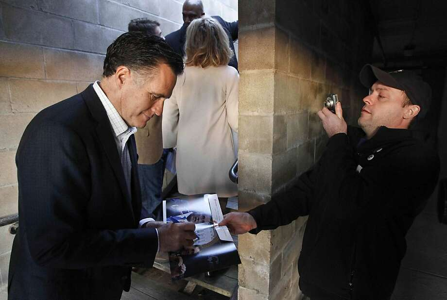 In this Dec. 28, 2011 file photo, Mitt Romney signs an autograph during a campaign stop at Elly's Tea and Coffee in Muscatine, Iowa. (AP Photo/Chris Carlson) Photo: Chris Carlson, Associated Press