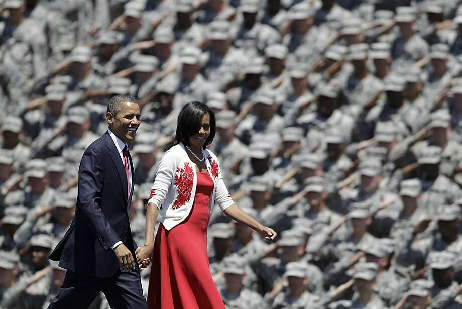In this April 27, 2012 file photo, President Obama and first lady Michelle Obama are saluted by soldiers as they arrive at the Fort Stewart Army post in Fort Stewart, Ga. (AP Photo/David Goldman, File) Photo: David Goldman, Associated Press