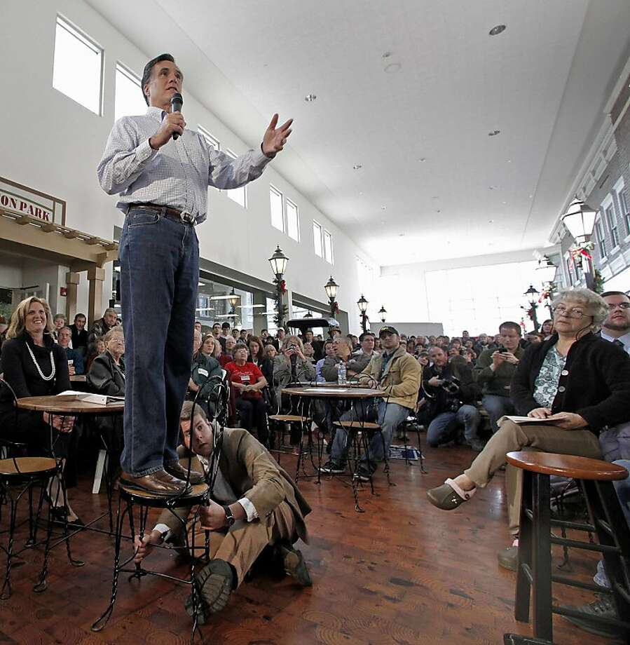 In this Dec. 29, 2011 file photo, Mitt Romney speaks during a campaign stop at the Music Man Square in Mason City, Iowa. (AP Photo/Charlie Riedel, File) Photo: Charlie Riedel, Associated Press