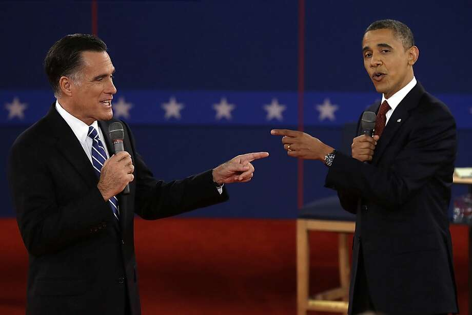 In this Oct. 16, 2012 file photo, Republican presidential candidate, former Massachusetts Gov. Mitt Romney and President Barack Obama spar during the second presidential debate at Hofstra University in Hempstead, N.Y. (AP Photo/Charlie Neibergall, File) Photo: Charlie Neibergall, Associated Press