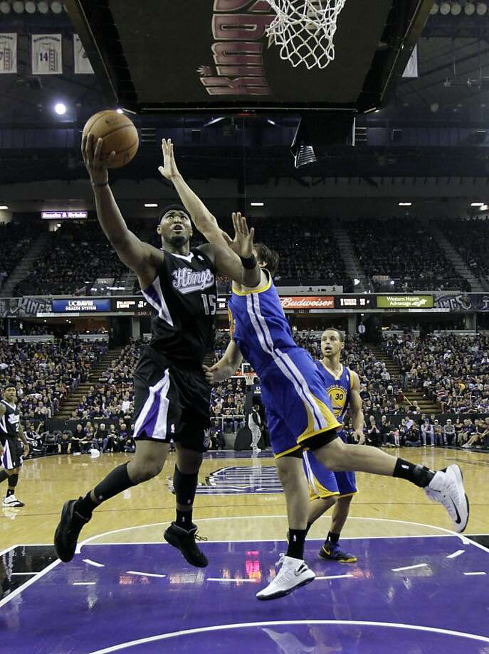 Sacramento Kings center DeMarcus Cousins, left, drives to the basket against Golden State Warriors center Andrew Bogut, of Australia, during the second half of an NBA basketball game in Sacramento, Calif., Monday, Nov. 5, 2012.  The Kings won 94-92.(AP Photo/Rich Pedroncelli) Photo: Rich Pedroncelli, Associated Press
