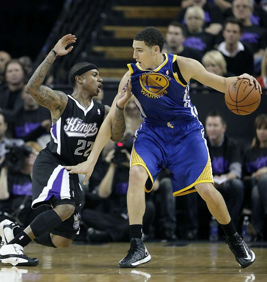 Sacramento Kings guard Isaiah Thomas, left, defends against Golden State Warriors Klay Thompson during the second half of an NBA basketball game in Sacramento, Calif., Monday, Nov. 5, 2012. The Kings won 94-92. (AP Photo/Rich Pedroncelli) Photo: Rich Pedroncelli, Associated Press