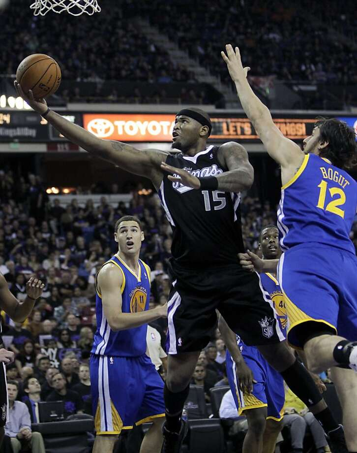 Sacramento Kings center DeMarcus Cousins, center, drives to the basket between Golden State Warriors' Klay Thompson, left, and Andrew Bogut, of Australia, during the second half of an NBA basketball game in Sacramento, Calif., Monday, Nov. 5, 2012.  The Kings won 94-92.(AP Photo/Rich Pedroncelli) Photo: Rich Pedroncelli, Associated Press