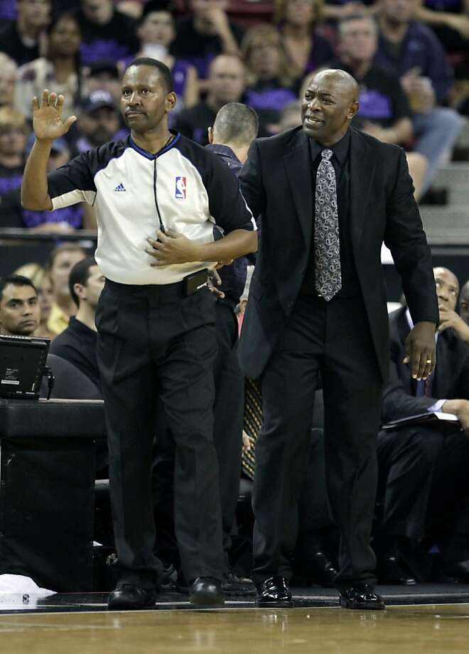 Sacramento Kings head coach Keith Smart, right, questions official James Capers about a foul call during the second half of an NBA basketball game against the Golden State Warriors in Sacramento, Calif., Monday, Nov. 5, 2012.  The Kings won 94-92. (AP Photo/Rich Pedroncelli) Photo: Rich Pedroncelli, Associated Press