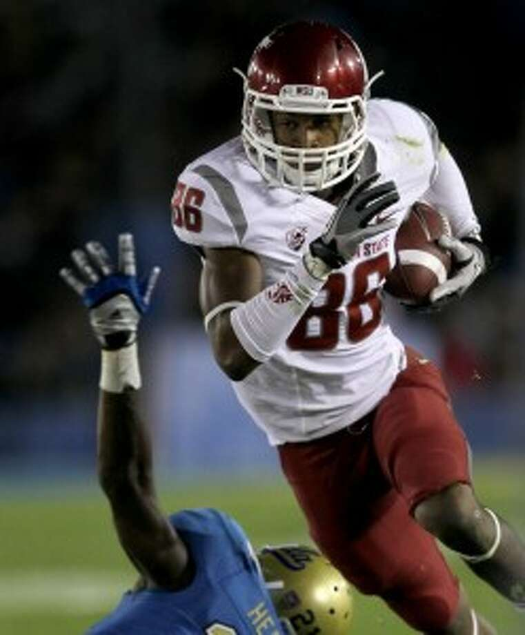 WSU's leading receiver Marquess Wilson was suspended from the team this week indefinitely for an unspecified violation of team rules after walking out of a conditioning session this past weekend. Wilson later said in a statment that quit the team because of abuse by Mike Leach and his coaching staff, which have gone winless in Pac-12 play. (Stephen Dunn/Getty Images)