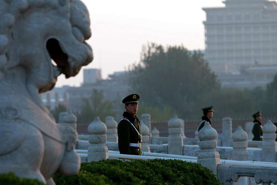 In this photo taken Tuesday, Nov. 6, 2012, Chinese paramilitary policemen guard the bridges leading to Tiananmen Gate in Beijing. Authorities want no more surprises as party leaders convene in the capital, and rights groups say the wide-ranging crackdown on critics bodes poorly for those who hope the incoming generation of leaders will loosen restrictions on activism. Photo: Alexander F. Yuan