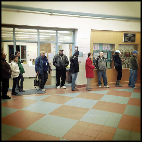 Long lines await voters at Westover Elementary School in Stamford, the polling location for districts 8 and 10 on Election Day, November 6, 2012. Photo: Chris Preovolos / Stamford Advocate