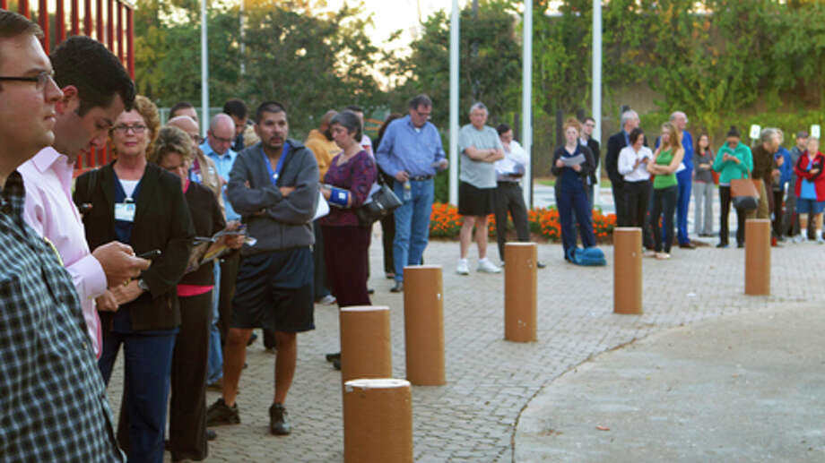 Voters wait outside the West Gray Recreation Center Tuesday, Nov. 6, 2012, in Houston. Photo: Cody Duty, . / © 2012 Houston Chronicle