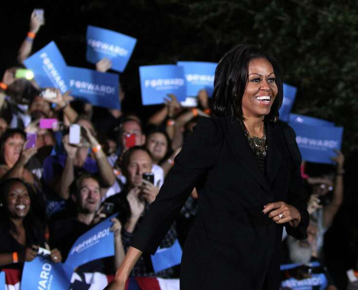 First lady Michelle Obama gets a warm welcome as she takes the stage during a campaign rally in Orla