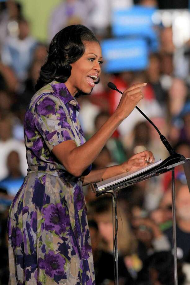 First lady Michelle Obama  speak to a packed house at the Ocean Center in Daytona Beach, Fla., Thursday, Nov. 1, 2012. (AP Photo/The Daytona Beach News-Journal, David Massey) Photo: David Massey, Associated Press / The Daytona Beach News-Journal