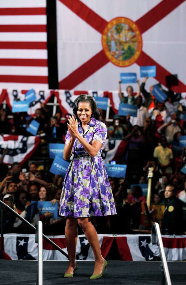 First lady Michelle Obama claps after speaking to supporters at a campaign event at the James L. Knight Center, Thursday, Nov. 1, 2012 in Miami. (AP Photo/Wilfredo Lee) Photo: Wilfredo Lee, Associated Press / AP