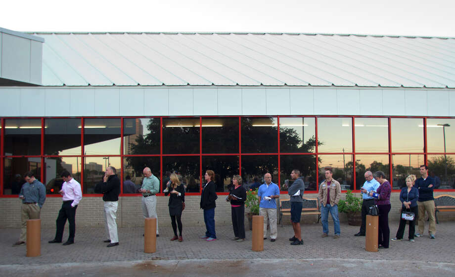 Voters wait outside the West Gray Recreation Center Tuesday, Nov. 6, 2012, in Houston. Photo: Cody Duty, Houston Chronicle / © 2012 Houston Chronicle
