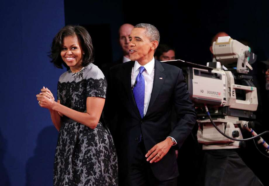 President Barack Obama and first lady Michelle Obama smile after the presidential debate at Lynn University in Boca Raton, Florida, Monday, October 22, 2012. (Richard Graulich/Palm Beach Post/MCT) Photo: Richard Graulich, McClatchy-Tribune News Service / Palm Beach Post