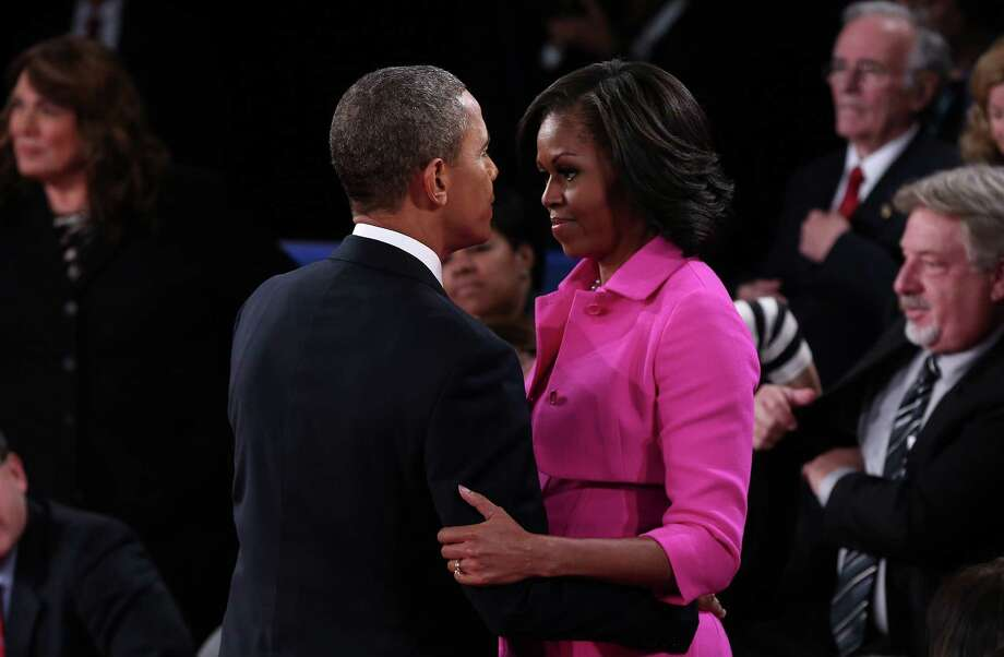 HEMPSTEAD, NY - OCTOBER 16: U.S. President Barack Obama hugs Michelle Obama after a town hall style debate with Republican presidential candidate Mitt Romney at Hofstra University October 16, 2012 in Hempstead, New York. During the second of three presidential debates, the candidates fielded questions from audience members on a wide variety of issues. Photo: Win McNamee, Getty Images / 2012 Getty Images
