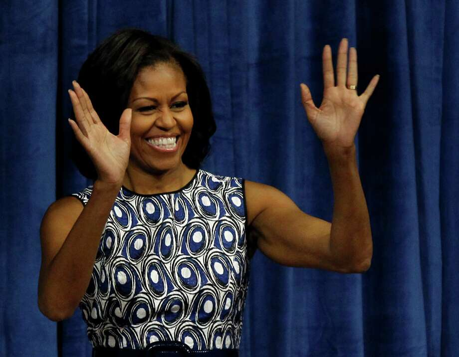 First lady Michelle Obama waves to the crowd as she enters Carmichael Arena on the campus of University of North Carolina-Chapel Hill, in Chapel Hill, N.C., Tuesday, Oct. 16, 2012. She was making a campaign stop for her husband, President Barack Obama. (AP Photo/The News & Observer, Chuck Liddy) Photo: Chuck Liddy, Associated Press / The News & Observer